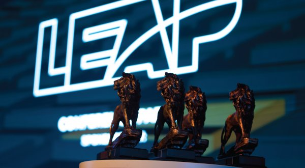 Several awards in the shape of lions with the words LEAP in the background